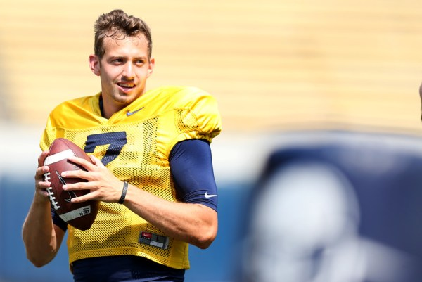 New Cal quarterback Davis Webb grabs a ball during practice at Memorial Stadium in Berkeley, Calif., on Friday, Aug. 19, 2016. (Ray Chavez/Bay Area News Group)