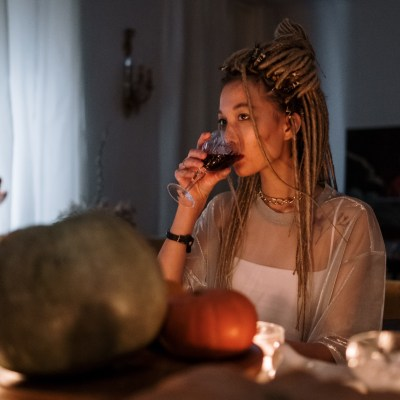 drinking wine at table with pumpkins pexels-cottonbro-6555011