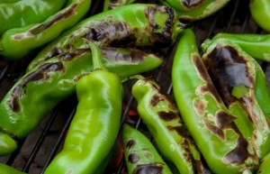 Hatch Chiles roasting over a fire