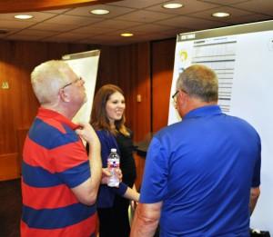 Planning Assistant Kim Varner (center) explains commercial zoning categories during the open house.