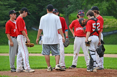 BANC head coach Steve DeRosa talks to his starting pitcher and infield during Monday's game. (Paul Silverfarb photo)