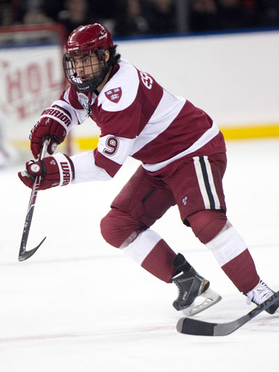 Harvard junior and Greenwich resident Luke Esposito darts down the ice during a recent game for the Crimson last year. (photo courtesy of Harvard Athletics)
