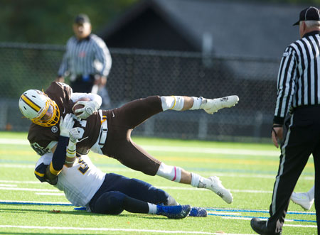 Brunswick's Spencer Decker makes the catch and gets taken down by a Trinity Pawling defender during Saturday's game. (John Ferris Robben photo)