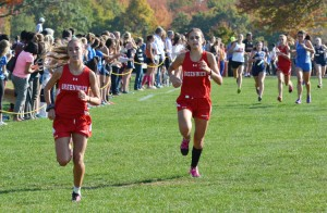 Members of the Greenwich High School girls cross-country team race towards the finish line during Wednesday's FCIAC championship held at Waveny Park in New Canaan. (Paul SIlverfarb photo)