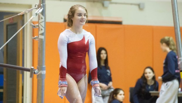 The Greenwich High School gymnastics team won the CIAC class L title for the first time in school history Saturday at Pomperaug, scoring 140.425. (John Ferris Robben photo)