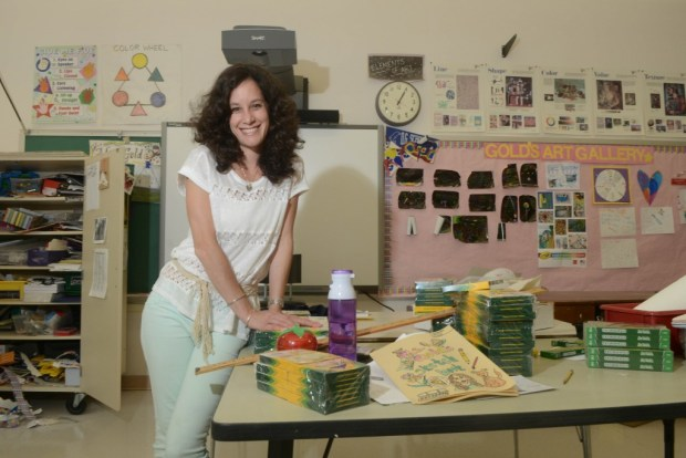 Suzanne Gold, an art teacher at Old Greenwich, sets up her classroom before the first day of school (John Ferris Robben Photo)