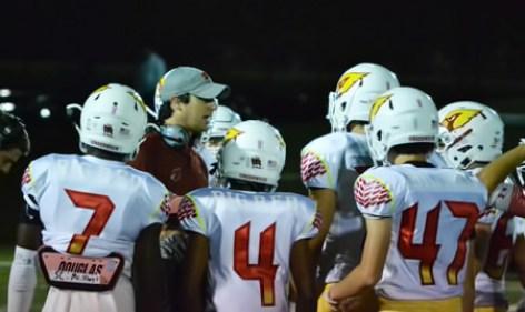Greenwich High School head coach John Marinelli talks to his offense during a timeout in Friday night's FCIAC clash against New Canaan. (Paul Silverfarb photo)