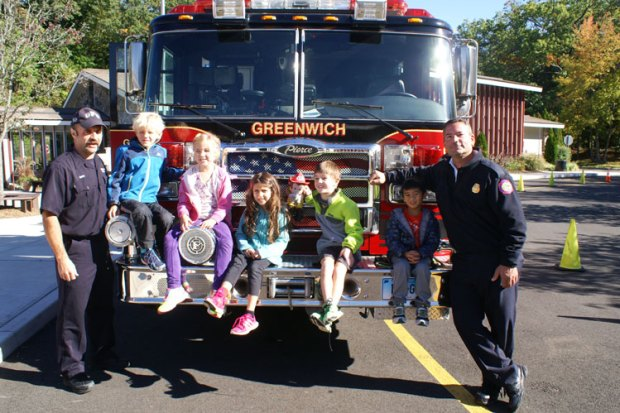 Pictured (L-R): Firefighter Bob Roth, with ISD first graders Max Townsend, Annabelle Cosby, Lelia Griffith, Dylan Murray and Cebastian Guico, and Deputy Fire Marshall Chris Pratico.