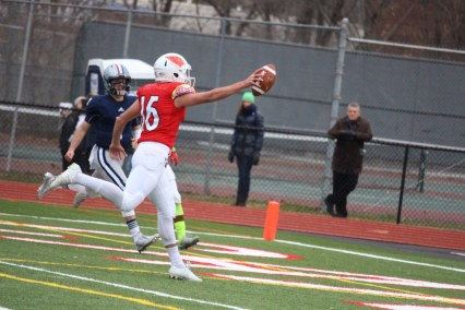 Greenwich's Cole Hartley crosses the end zone in Wednesday's win over Staples (Evan Triantafilidis photo)