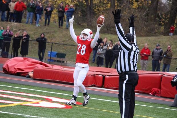 Greenwich's Matt Morganti celebrates after catching a touchdown pass against Staples (Evan Triantafilidis photo)