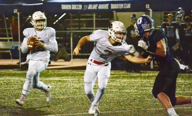 Greenwich High School sophomore quarterback Gavin Muir looks for the open receiver during Tuesday night's CIAC class LL quarterfinal game against Darien. (Paul Silverfarb photo)