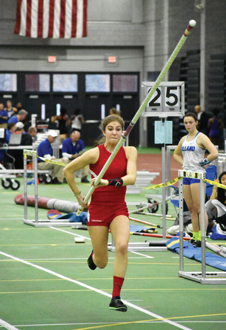Greenwich High School junior Lia Zavattaro darts to a third place finish in the pole vault during Monday's CIAC state open championship meet. (Paul Silverfarb photo)
