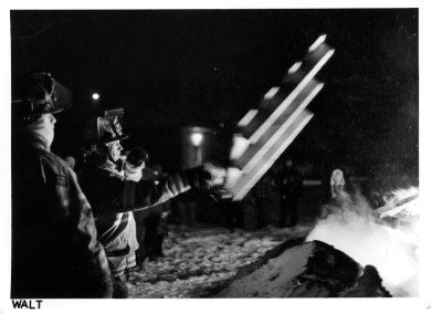 Walt throwing pallets at the bon fire. Minolta X700 Rokkor X 50 1.4