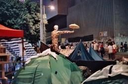 The umbrella man sculpture at night.