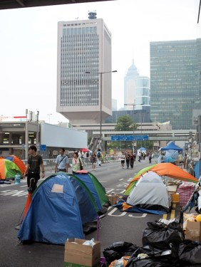 Tents on Connaught road over looking Tarmar, Site of People's Liberation Army Headquarters in Hong Kong. Formerly the Headquarters of British Overseas, Hong Kong.