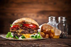 Close-up of home made burger on wooden background