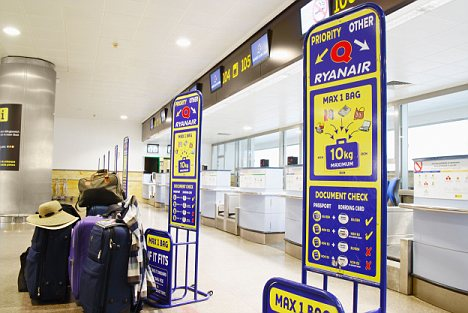 Empty Ryanair check in desks at Gran Canaria airport during volcanic ash cancellations.