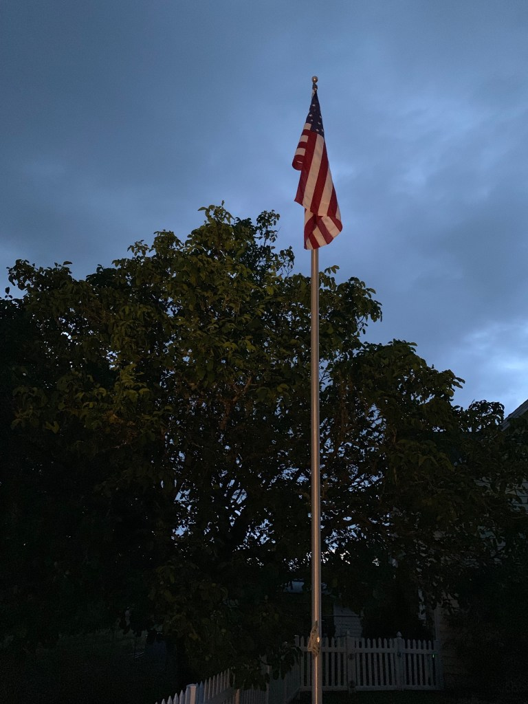 Lit flag at dusk