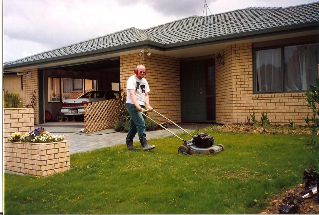 David mowing lawn