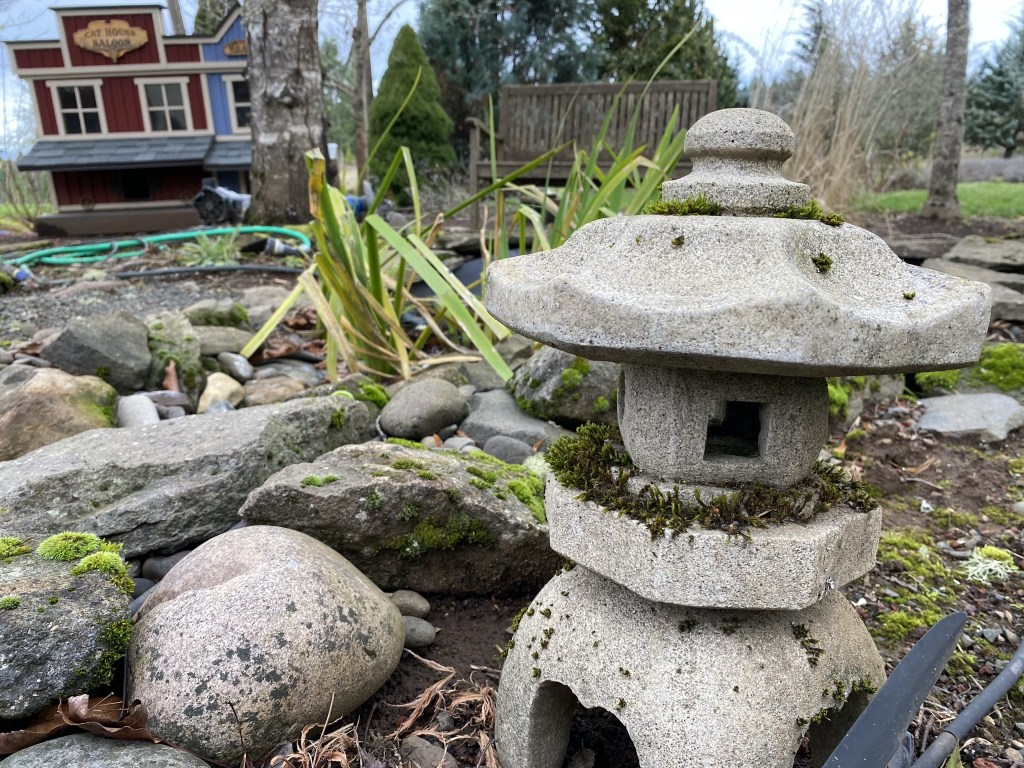 Japanese lantern by small pond