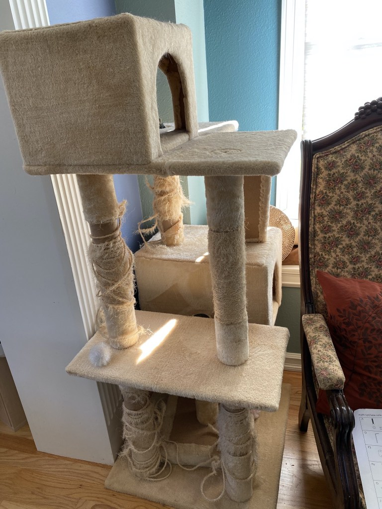 Old falling apart cat tower