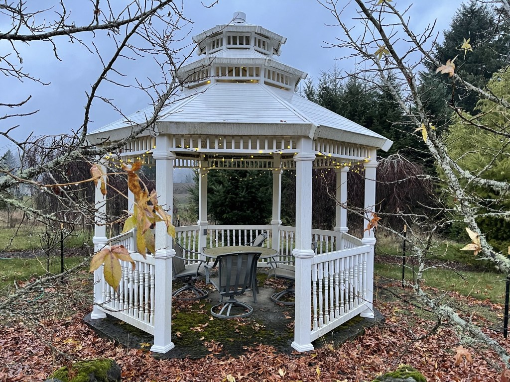 White gazebo with lights on