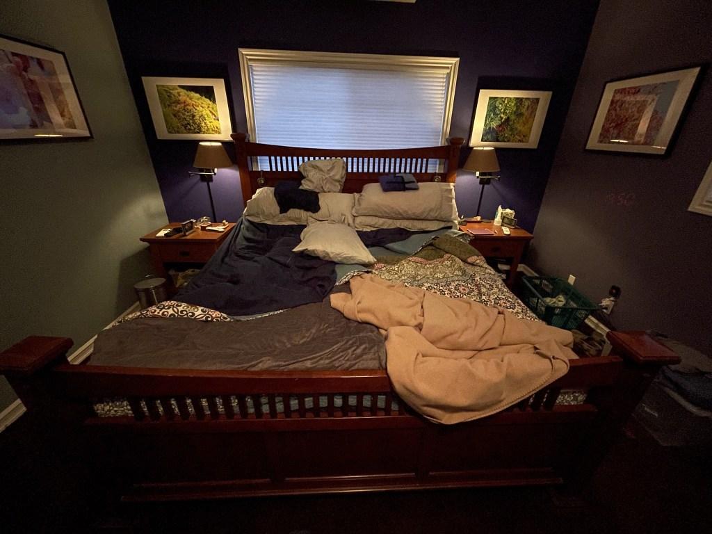 Tilt king bed, side tables, artwork