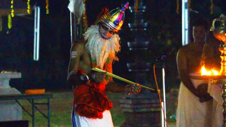 Artist-playing-the-role-of-Narada,-the-vedic-sage-in-Hindu-mythology-in-Mudiyettu