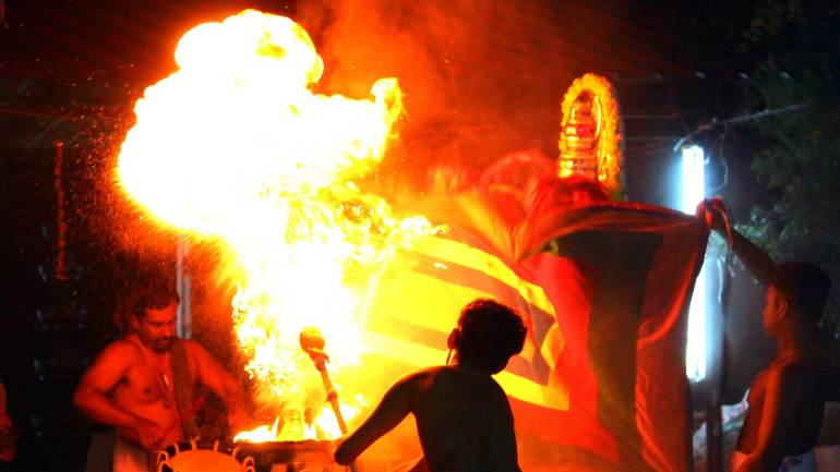 The-fireball-is-flaming-to-show-the-horrible-form-of-demon-Darika-in-Mudiyettu
