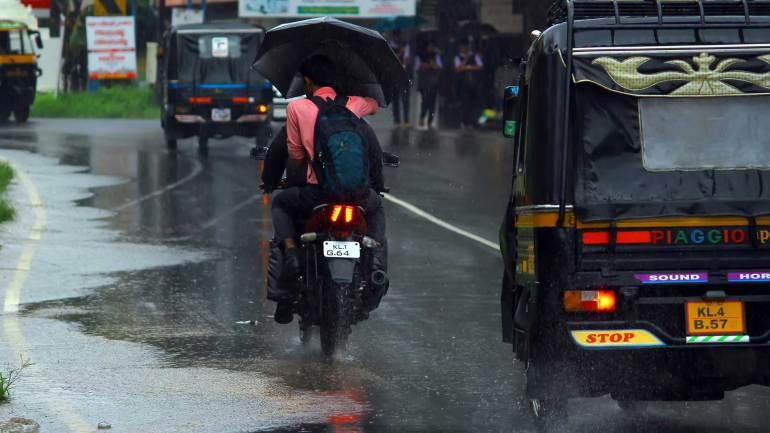 Kerala-Heavy-Rain-Kerala-Monsoon-two-wheeler-Passengers
