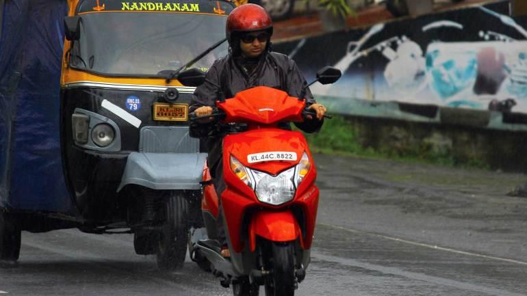 Kerala-Heavy-Rain-Kerala-Monsoon-wet-two-wheeler-Passenger