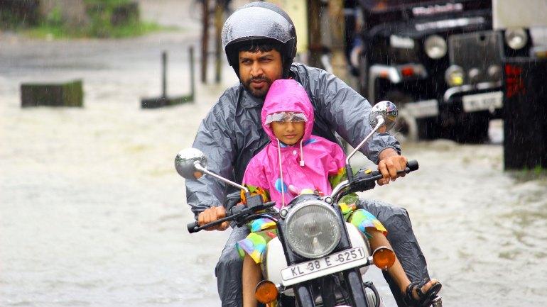 Kerala-Monsoon-Child-Safe-on-His-Fathers-Lap, Kerala Mon