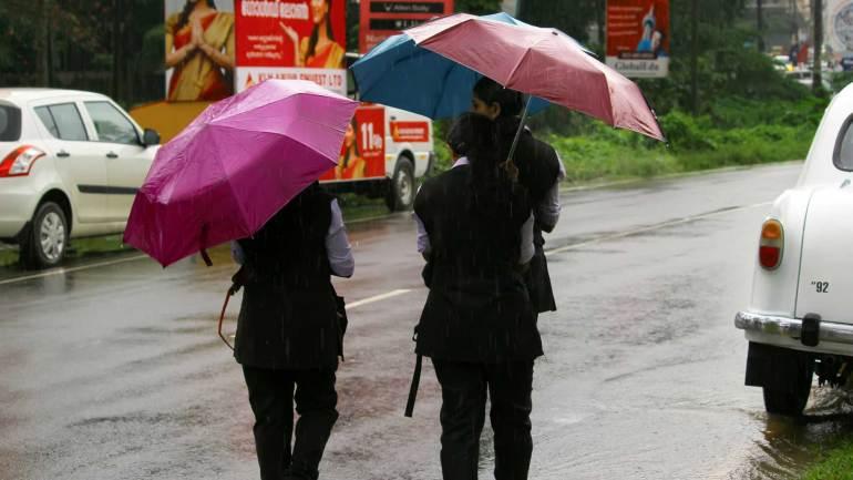 Students-walking-withumbrella-in-heavy-rain