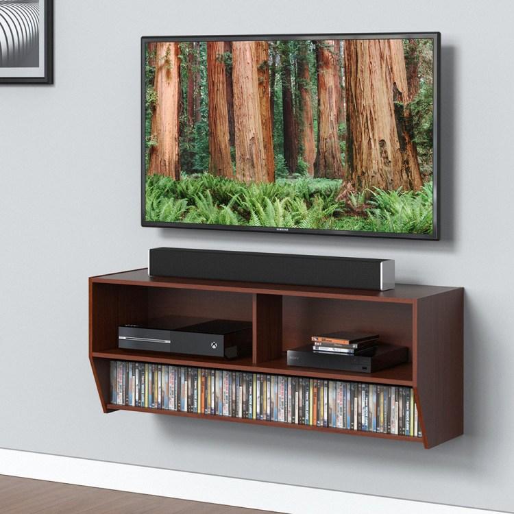 Jenis meja tv yang kedua adalah rak TV yang sangat pas kamu gunakan jika  tipe meja TV dirasakan masih terlalu memakan banyak tempat dan ruangan. 9eec0c6585