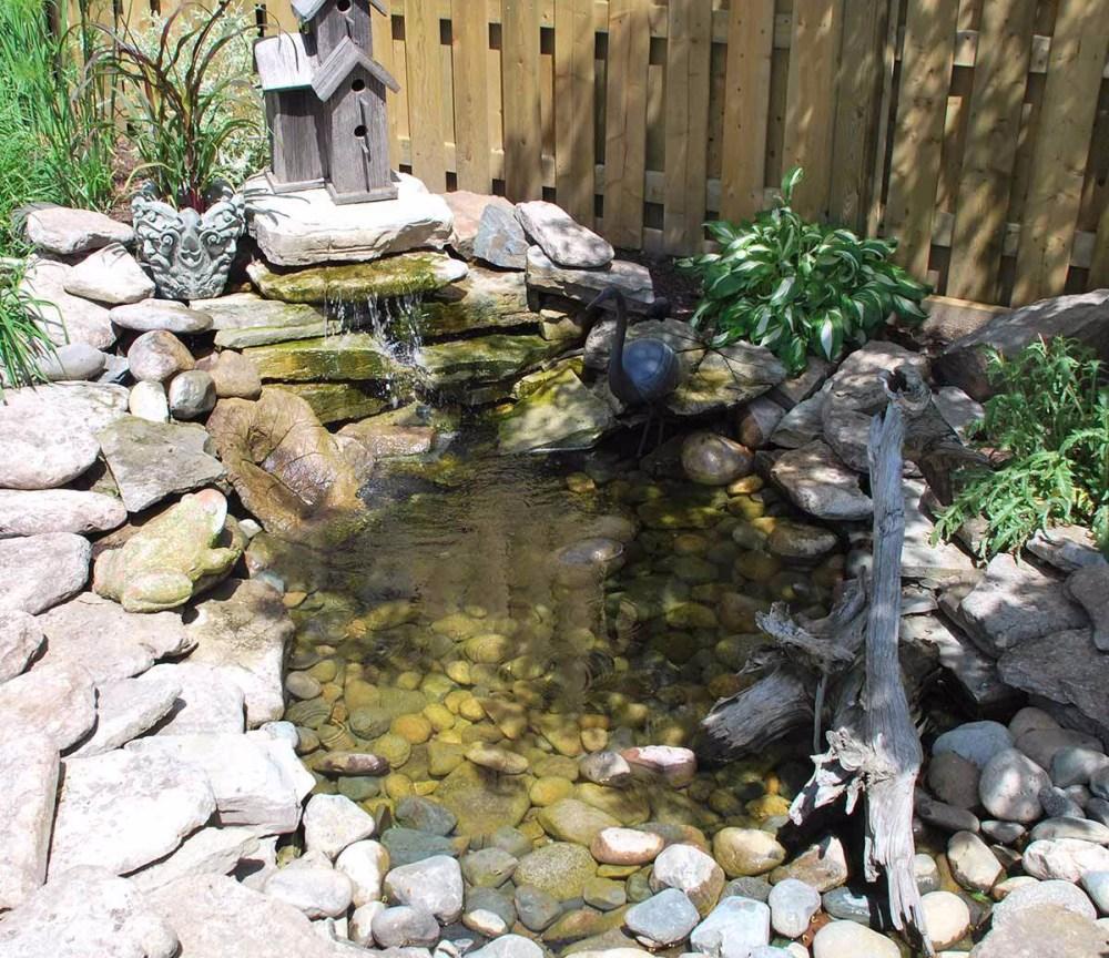 Kolam Ikan Mini Air Terjun Berunduk