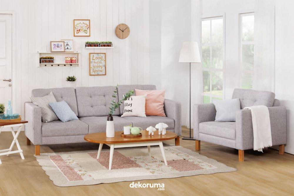 Sofa berwarna netral dengan sentuhan warna pastel