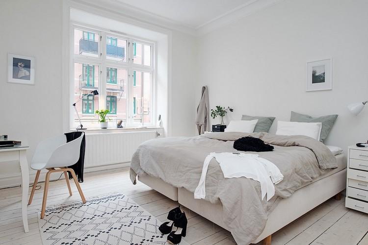 Desain kamar tidur utama bergaya Skandinavia untuk kepribadian sederhana dan pecinta alam