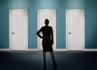 businesswoman-female-woman-lawyer-making-decision-deciding-choice-doors-300x215