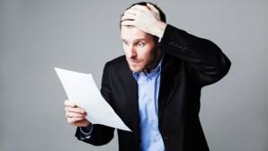 terrified businessman reading document