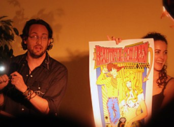 Charles Bock auctioning off a poster