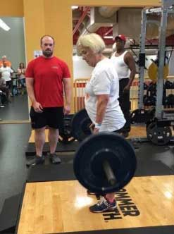 Taylor Rehberg, 79, set records in the deadlift (135 pounds), bench press (65) and bench press repetitions (17).