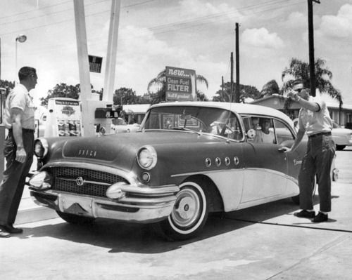 asking for directions at a gas station in the 50s