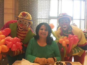 Mother with the cheerful clowns who gave roses to us all