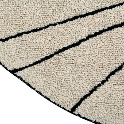 detalle de la alfombra lavable race color crema de lorena canals