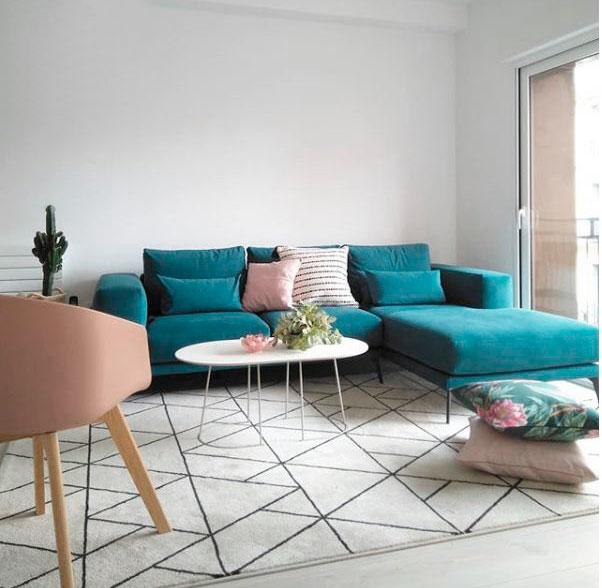 zona de salón con sofá azul verdoso