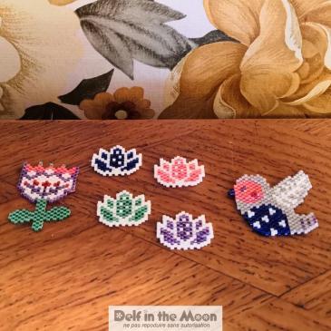 Pin's et broche / fleurs et oiseau