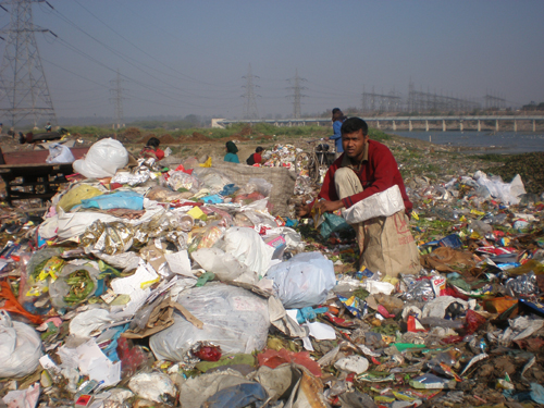 Rag pickers pick up plastic at a waste dump site in Delhi