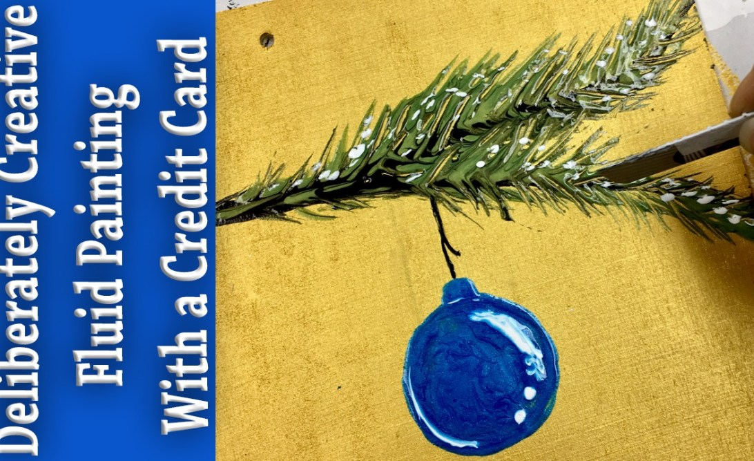 Blue Glass ornaments on a pine branch