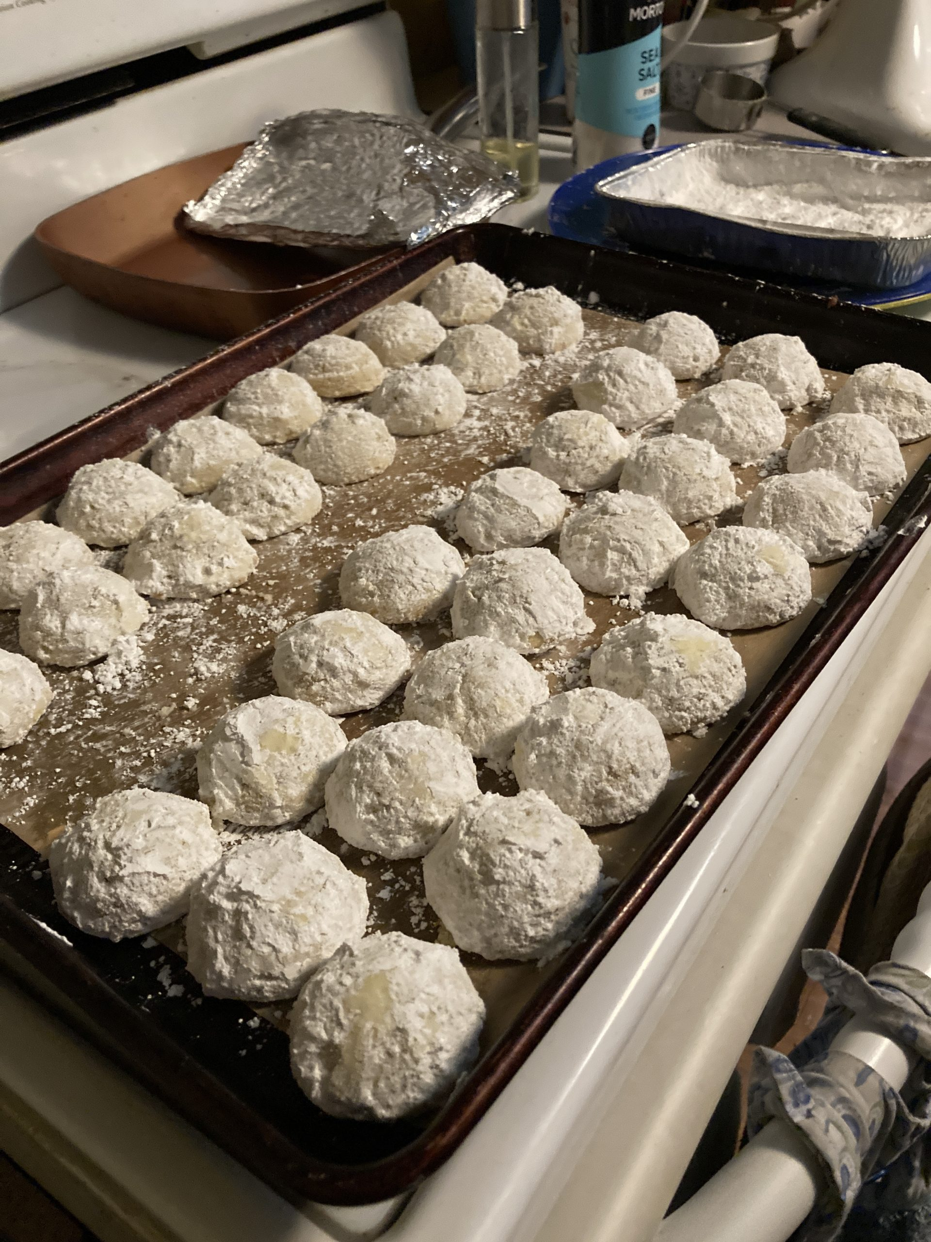 pan of snowball cookies waiting to be packed