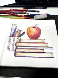Back to school supplies stacked books, pencils and pen in a cup and an apple on top of the books